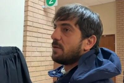 Video screenshot of Adam Catzavelos ahead of a court appearance.