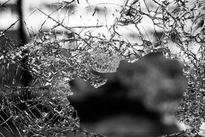 Broken window,  violence, conflict.
