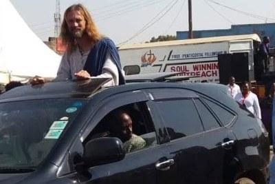 American actor, evangelist, and president at Jesus Loves You Evangelistic Ministries, Michael Job, in the streets of Kiserian in Kenya's Kajiado County.