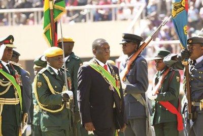 President Emmerson Mnangagwa and Commander of the Zimbabwe Defence Forces General Phillip Valerio Sibanda inspect a parade during Zimbabwe Defence Forces Day celebrations (file photo).