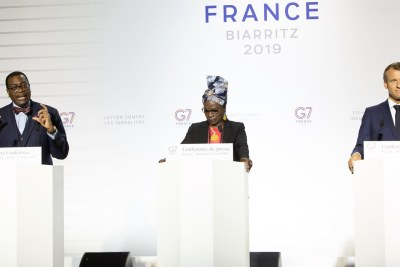 From left, African Development Bank President Akinwumi Adesina,  Beninese singer Angelique Kidjo and French president Emmanuel Macron announce the donation of U.S.$251 million to support women entrepreneurs in Africa. Kidjo is a UNICEF goodwill ambassador who has been promoting the African Development Bank's initiative.