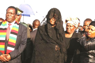 President Emmerson Mnangagwa, First Lady Auxillia Mnangagwa and former First Lady Grace Mugabe, centre, at the arrival of former President Robert Mugabe's body from Singapore at Robert Gabriel Mugabe International Airport in Harare.
