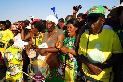 Zanu-PF supporters at the airport for the return home of Robert Mugabe's body.