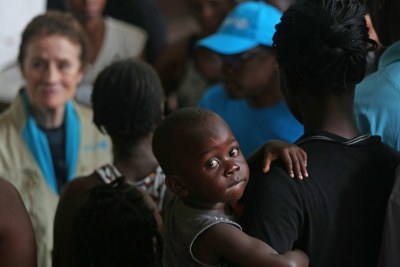 UNICEF Executive Director Henrietta H. Fore speaks with internally displaced people as she visits a secondary school used to shelter evacuees from Cyclone Idai (file photo).