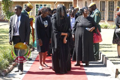 Former First Lady Grace Mugabe, all in black, with her sister Shuvai Gumbochuma, carrying red handbag, at the burial of Robert Mugabe in Zvimba.