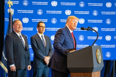 Secretary of State Michael Pompeo, left, watches as President Donald Trump addresses journalists in New York on September 25, 2019 during the 74th Session of the UN General Assembly.
