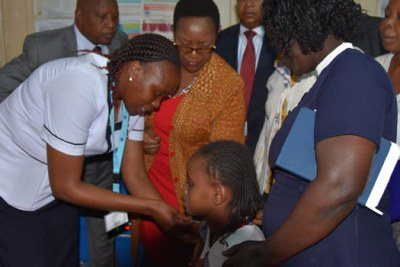 Health Cabinet Secretary Sicily Kariuki witnesses the vaccination a 10 year old girl with HPV vaccine at Othaya Health Centre in Nyeri County (file photo).