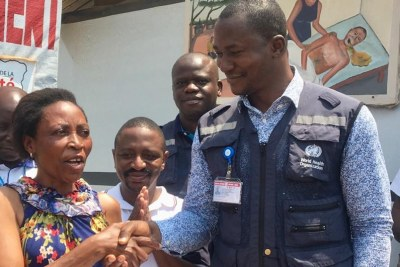 Dr Keïta, World Health Organisation Beni Field Coordinator, congratulates Masiko Muhaso, the last patient to leave the Ebola treatment centre,