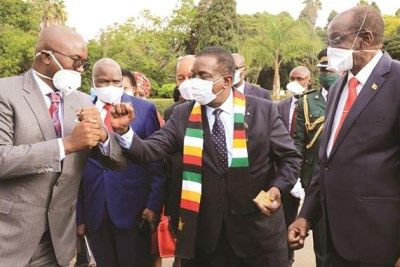 President Emmerson Mnangagwa greets Sakunda Holdings chief executive Kudakwashe Tagwirei after the donation of protective gear and other equipment valued at U.S.$6,4 million to Arundel Hospital. Looking on are Vice President Kembo Mohadi and Cabinet ministers.