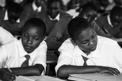 Students taking notes in class as part of a Mastercard Foundation partnership with STiR Education.