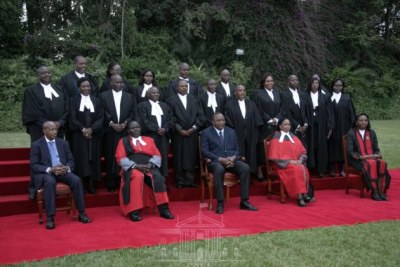 President Uhuru Kenyatta poses with a photo with the new judges who took the oath of office at State House, Nairobi on June 4, 2021