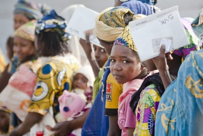 Central African mothers and children queue for food at the Timangolo refugee centre in Cameroon in 2019 (file photo).