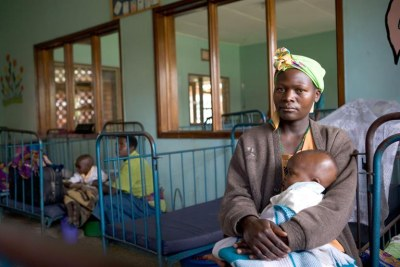According to the World Health Organization, approximately 90% of malaria cases and deaths occur in sub-Saharan Africa, including Uganda where this women is seeking treatment for her child.